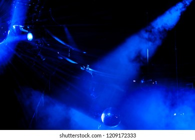 Disco ball with bright blue rays, night party background photo