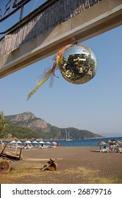Disco ball hanging at the gate of the beach