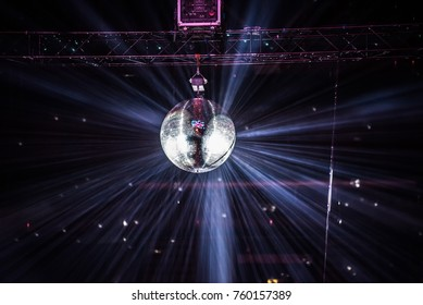 Disco ball, mirror ball hanging at a retro party