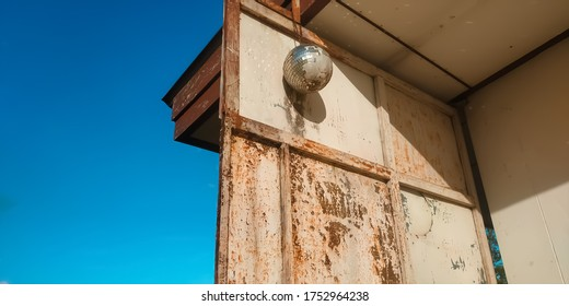 Disco ball and old wall with clearly blue sky