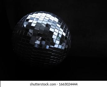 disco ball on a dark background. mirror ball