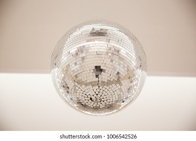 disco ball with reflective surface white backraund