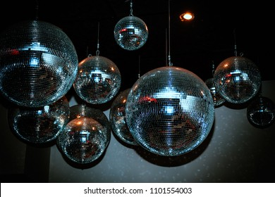 Disco balls in a dark nightclub room