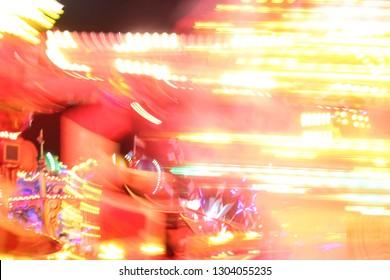 disco lights synth wave retro neon lights fairground ride night lights funfair park moving, light trails,  long exposure illuminations futuristic sci fi synthwave stock photo, stock, photograph, image