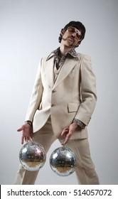 Disco man with his shiny pair of disco balls