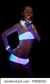 Disco sexy girl with glow make-up silence sign