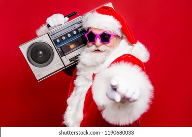 Disco trendy noel christmastime eve winter wish December stylish funky aged mature star Santa tradition costume white beard vintage record indicate show point fingers isolated red background