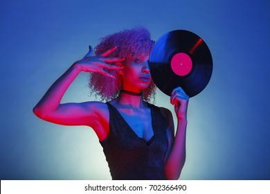 disco woman holding a retro vinyl with eighties disco style