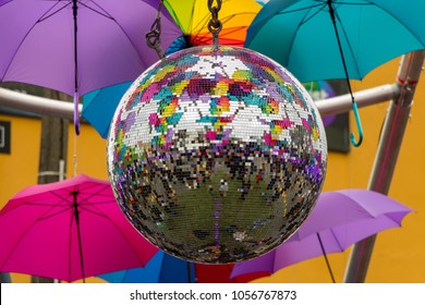 Discoball With Colorful Umbrellas In Background