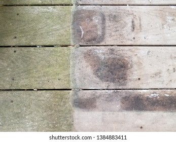 discolored or worn or weathered wood deck boards with algae