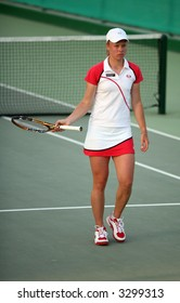 Disconsolate Vera Dushevina during a doubles match at the Qatar Open in 2006.