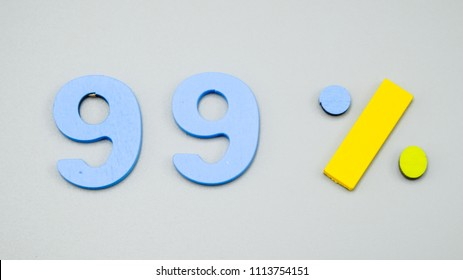 Discount 99%.sale 99% - wooden sign symbol lie on gray table background.