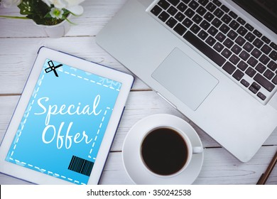 Discount coupon against tablet on desk