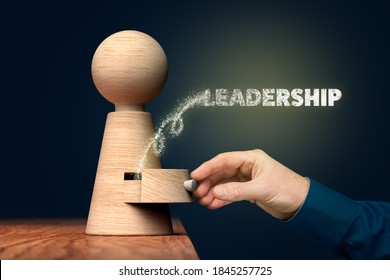 Discover your leadership skills concept. Coach (manager, mentor) open drawer from wooden figurine, there is hidden leadership skills going out.