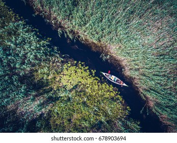 Discovering Danube Delta in a Canoe. Aerial view with a drone.