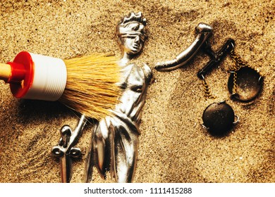 Discovering Justice figure buried in sand during police forensic investigation, conceptual image for cold case crimes being solved and criminals being punished