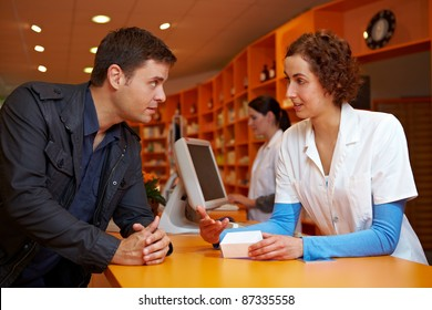 Discrete talk between customer and pharmacist in pharmacy