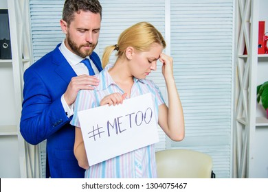 Discrimination assault complaint. Female assault statistic. Girl hold poster hashtag me too while colleague calm down her. Victim assault at workplace. Worker share assault story. Looking for support.