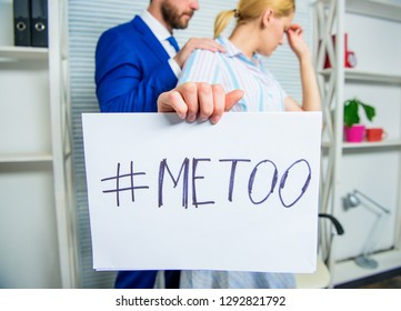Discrimination assault complaint. Scandal sexual abuse victim. Assault at workplace. Assault targeted at employee. Girl hold poster hashtag me too while colleague calm down her. Share assault story.