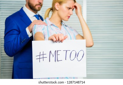 Discrimination assault complaint. Victim assault at workplace. Assault targeted at employee. Girl hold poster hashtag me too while colleague calm down her. Share assault story. Looking for support.