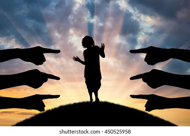 Discrimination and racism concept. Silhouette of hands of people point the finger at the woman