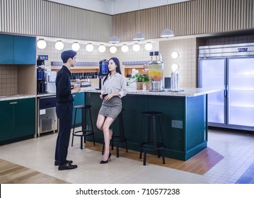 office pantry. discussing in pantry with collar worker office a