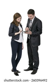 Discussion about electronic devise. Young man and woman keep tablet PC, touch screen and discuss its features.
