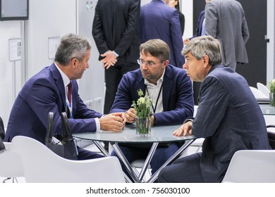 Discussion of people at the table. St. Petersburg, Russia - 3 October, 2017. Participants and visitors of the annual St. Petersburg Gas Forum.