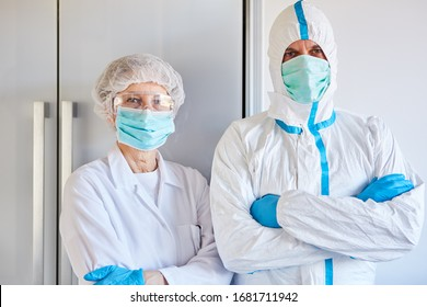 Disease control employees in protective clothing during coronavirus (Coivd-19) epidemic in a clinic