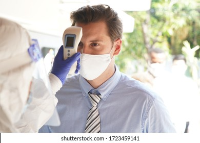 Disease control experts  use an Infrared thermometer equipment to check the temperature on the forehead and use alcohol gel to screen the patients addicted to Covid before entering the building.