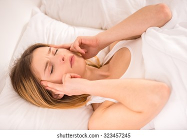 Disease. Young woman in bed at home