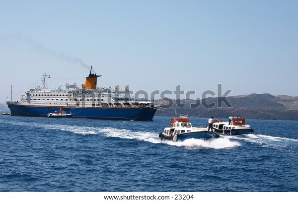 Disembarking from a holiday cruise liner at Fira harbour, Santorini, Greece.