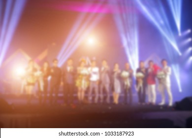 Disfocus of the Success people or businessman on stage with lighting in the business award ceremony