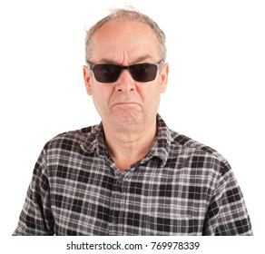 A disgruntled guy is wearing sunglasses