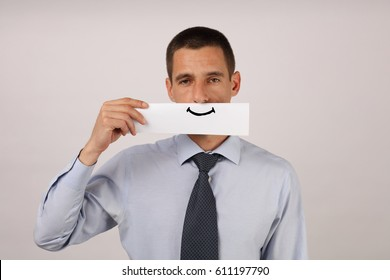Disgruntled, unsatisfied employee with artificial smile