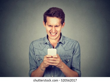 Disgusted man reading a text message