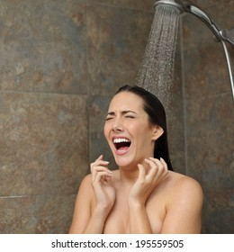 Disgusted woman screaming in the shower under a cold water jet