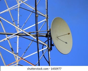 A dish antenna on a metal tower