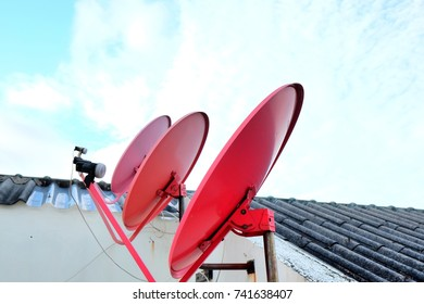 Satellite dish antennas on deck with blue sky