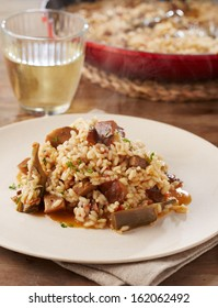 Dish of artichokes and red pine mushrooms rice