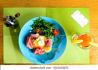 Dish with bacon, tomatoes and eggs, hot tea on a table at a cafe. Top view, flat lay and card with copyspace for text