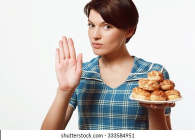 Dish of bakery products in the hands of women, diet
