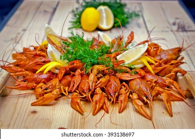 dish with boiled crawfish, lemon, dill and spices, boiled crawfish beer