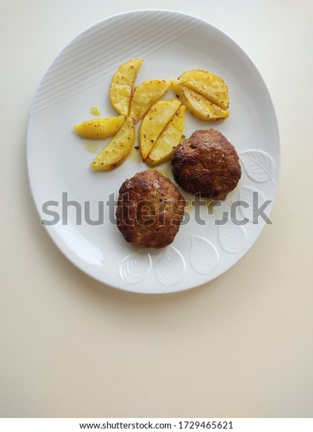 dish-burgers-baked-potatoes-on-600w-1729