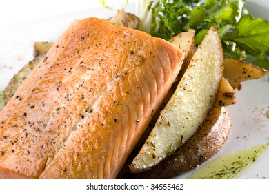 A dish of Chilean grilled Salmon over a bed of potatoes