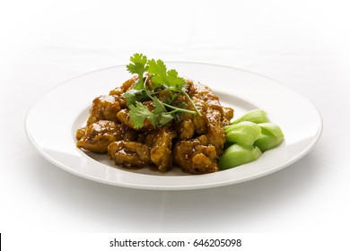 a dish chinese sesame chicken on white isolated background