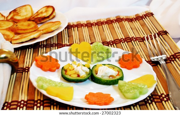 Dish, decorated vegetable hearts and flowers. Vegetarian.