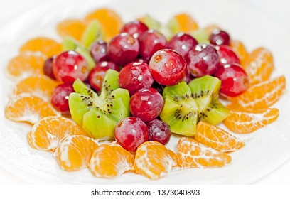 Dish with different fresh fruits.