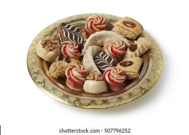 Dish with festive moroccan cookies on white background