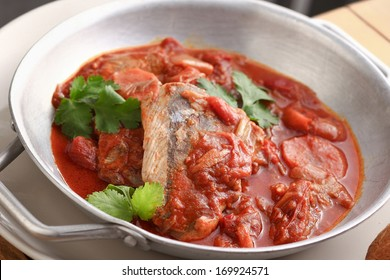 a dish of fish and tomato sauce